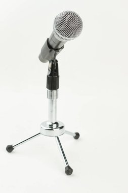 Gray microphone on short stand.