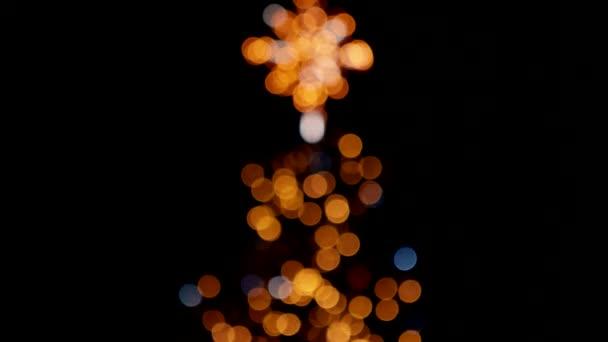 Weiße Lichter blinken über orangefarbene.