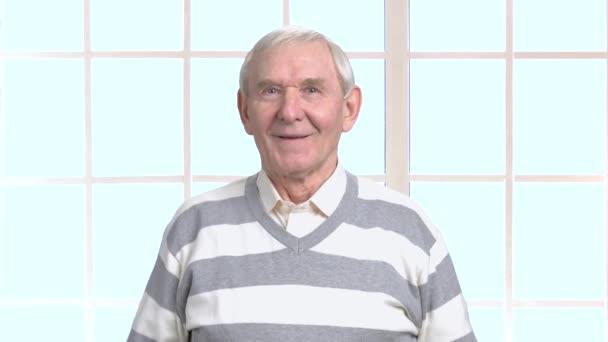 Elderly man in excitement, blurred background.