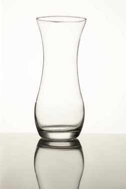 Clear glass vase isolated on a white background.