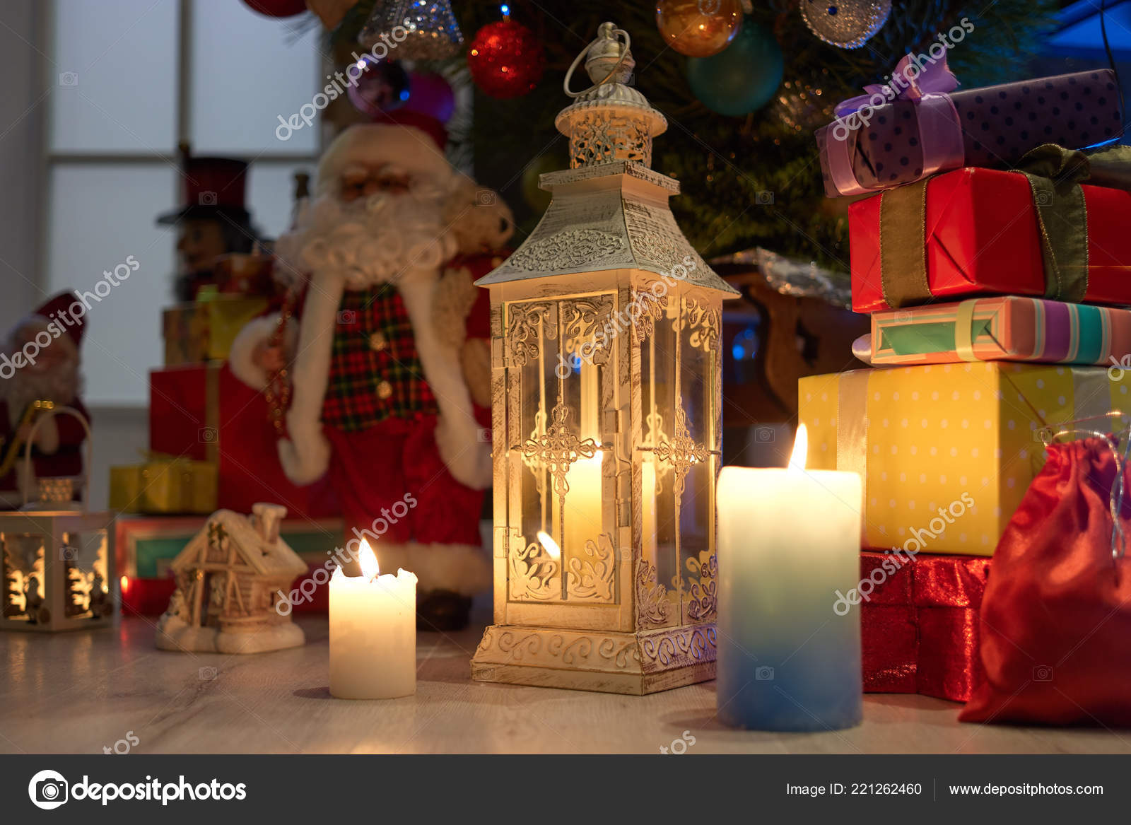 christmas scene with lanterns candles and gifts stock photo
