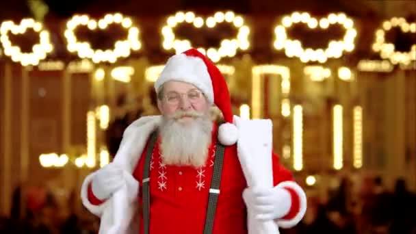 Santa Claus na nový rok světla pozadí.