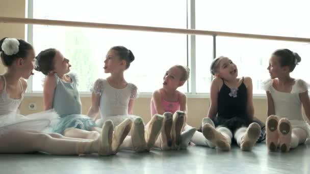Six little ballerinas having fun.