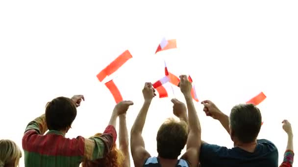Happy people waving the flags of Poland.