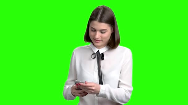 Girl pulls the phone out from her back pocket.