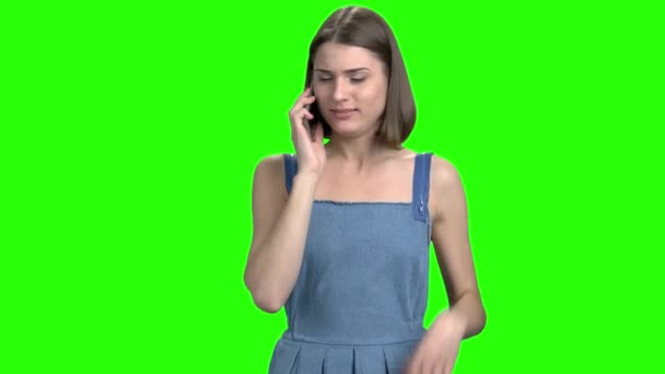 Emotional energetic woman talking on phone, front view.