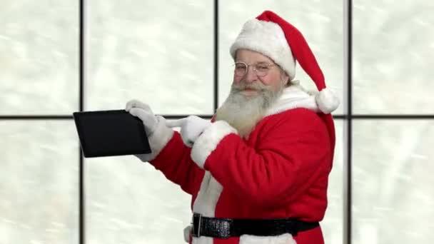 Happy Santa Claus presents pc tablet.