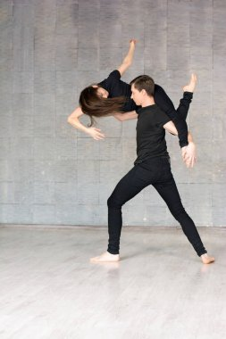 Young couple dancing in dynamic pose.