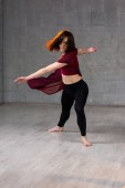 Young woman performing modern dance.