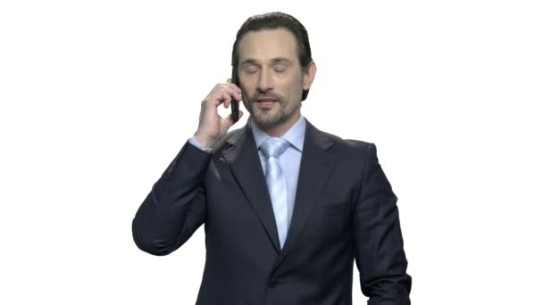 Good-looking mature businessman talking on cell phone.