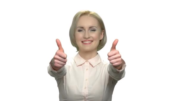 Excited business woman giving two thumbs up.
