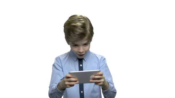 Cute little boy playing game on smartphone.