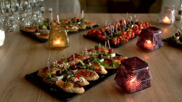 Delicious snacks and appetizers on banquet table.