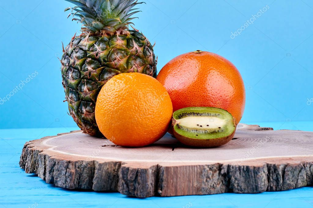 Set of exotic fruits on blue background.