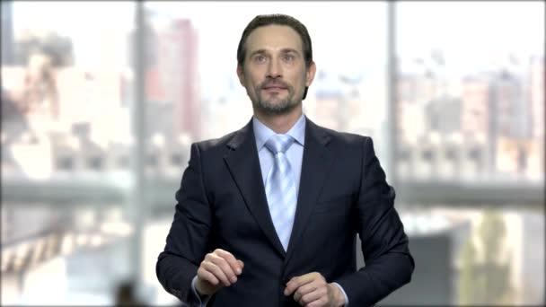 Mature businessman touching virtual screen.