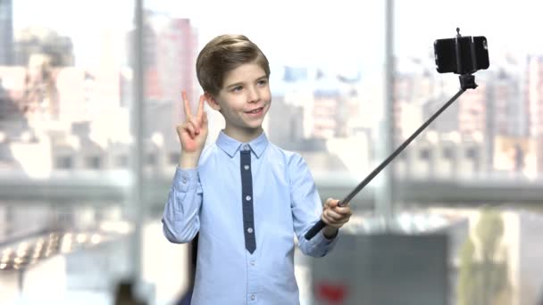 Little boy with monopod on blurred background.