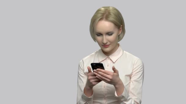 Attractive business woman using cell phone.