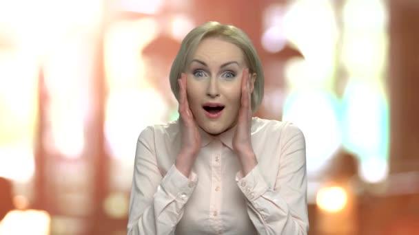 Portrait of surprised happy business woman.
