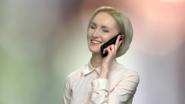 Satisfied office woman talking on phone.