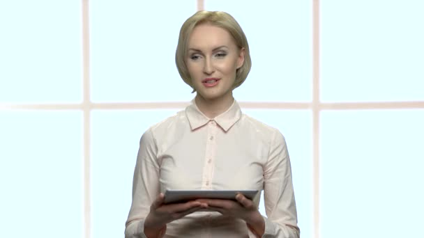 Beautiful business woman using tablet device.