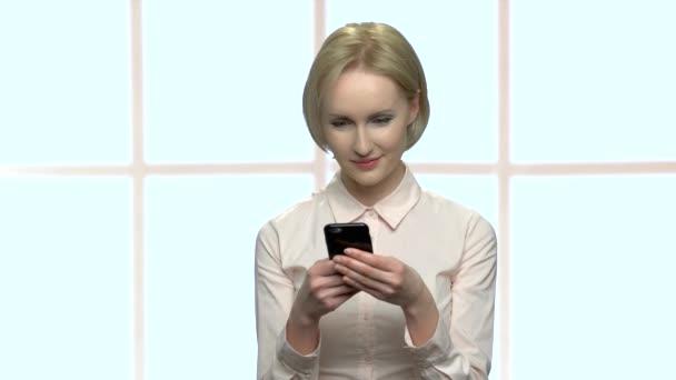 Beautiful business woman using mobile phone.