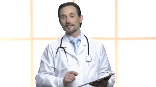 Confident mature doctor giving a lecture.