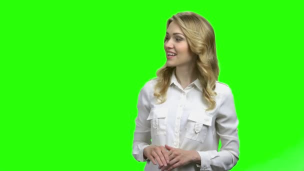 Smiling woman showing something on green screen.