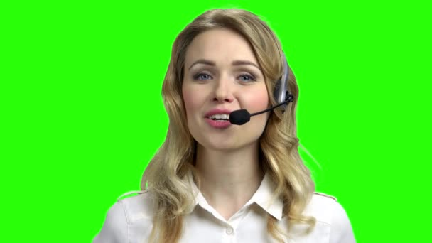 Beautiful consultant of call center on green screen.