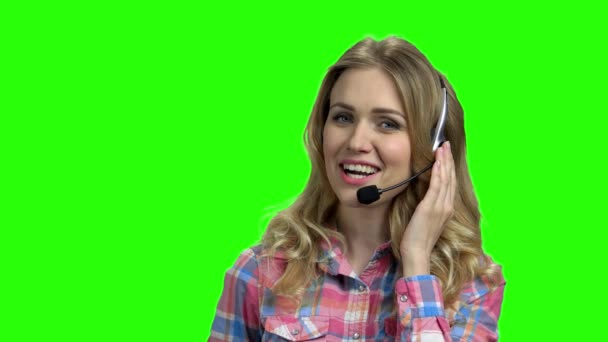 Portrait of beautiful call center operator on green screen.