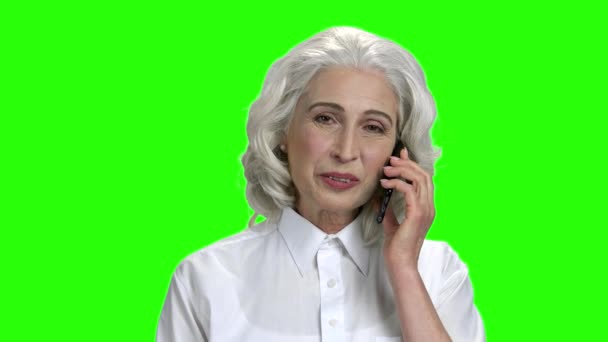 Smiling mature woman on green screen background.