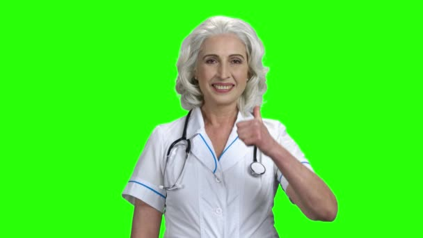 Senior woman doctor showing thumb up.