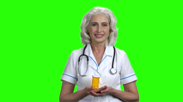 Female doctor presenting new pills.