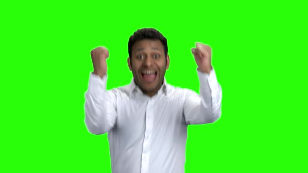 Happy overjoyed businessman on green screen.