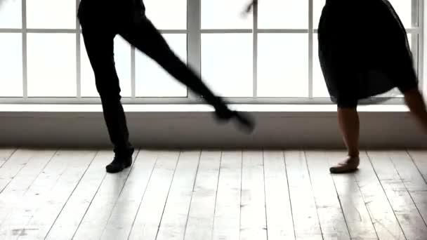 Ballet couple practicing dance in ballet class.