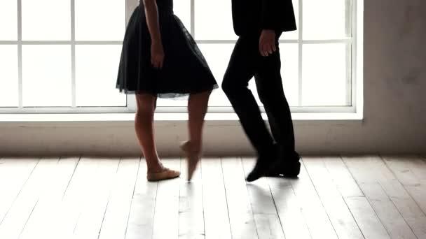 Ballet couple having rehearsal before performance.