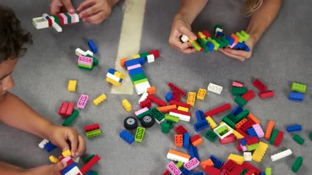 Kids playing building blocks toys.
