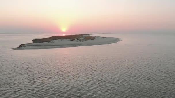 Beautiful orange sunset over sea water.
