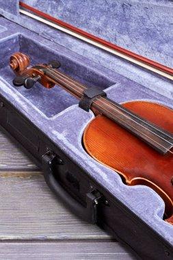 Vintage violin in purple velvet case.