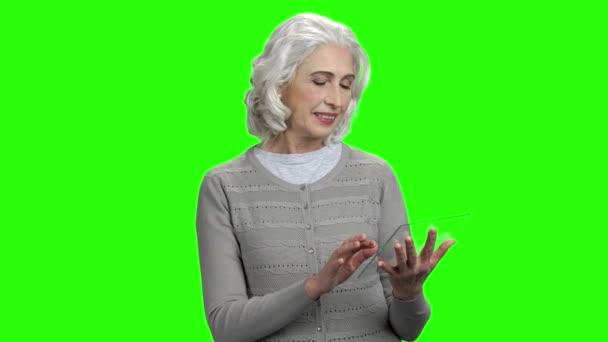 Woman using futuristic transparent tablet.