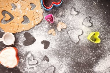 Cookies in the shape of hearts, cooking. Valentine's Day. Flat lay.