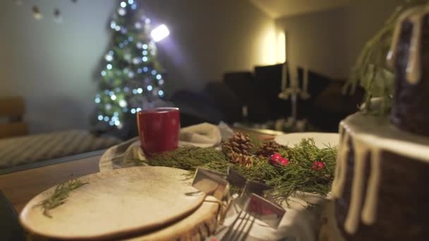 Magnificent festive cozy Christmas tree atmosphere in dining room with ginger cake on New Year celebration dinner table