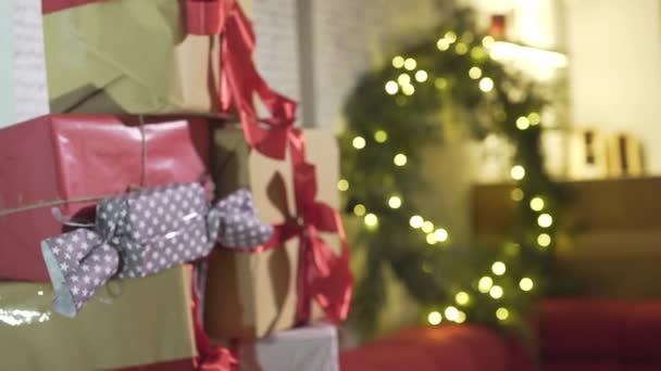Defocused gorgeous view on wrapped Christmas gifts presents pile in New Year tree in decorated festive atmosphere room
