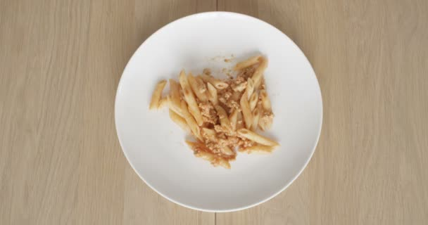 Eating Food Pasta Bolognese Top View of Plate on a Wooden Table in Time lapse