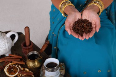 Female hands hold coffee beans