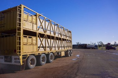 Empty and unhitched road train trailer waiting for load of cattle at Roma sales yards, Queensland,Australia.