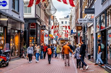 The busy Kalverstraat, a famous shopping street in the center of the old city of Amsterdam on a nice October day