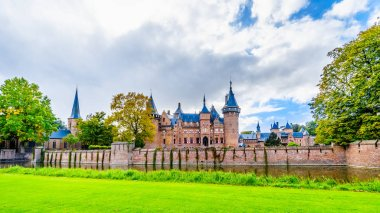 Haarzuilens, Utrecht/the Netherlands - Oct. 1, 2018: Magnificent Castle De Haar surrounded by Moats, Walls and beautiful manicured Gardens. A 14th century Castle completely restored in the late 19th century