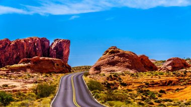 The White Dome Road winding through the Red sandstone rock formations in the Valley of Fire State Park in Nevada, USA