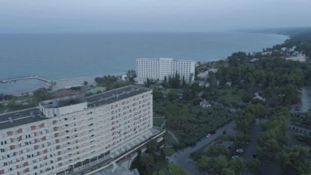 Aerial view. Big resort complex located by the coast of the Mediterranean Sea.  Resort complex next to Kallithea village, Greece. 4K