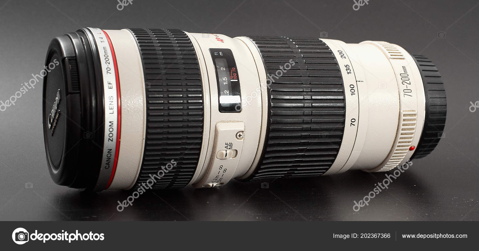 87bc383e GOMEL, BELARUS - July 2, 2018: Objective Canon 70 - 200 mm on a black  background — Photo by makALEX